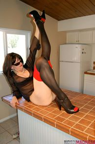 Mature Lady Wearing Sexy Stockings And Heels
